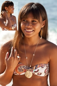 <h5>Ha&#039;a Keaulana</h5><p>Surfer, Stunt woman, Model &amp; Underwater Photographer Ha&#039;a Keaulana wears Surfer Girl Jewelry mother of pearl and puka shell necklace &amp; matching earrings.</p>