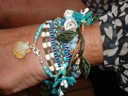 <p>Barbara wears Surfer Girl Jewelry turquoise braided bracelet with hand wire-wrapped sunrise shell. &#039;Sunrise Shells make me happy! Merci!&#039; ~Barbara</p>