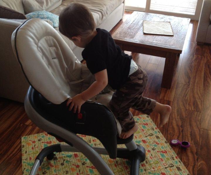 baby-climbing-high-chair